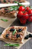Slice of tuna tart with olives and onions — Stock Photo