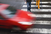 Car withh pedestrians — Stock Photo