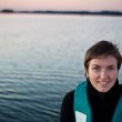 Young woman in life jacket on the lake — Stock Photo