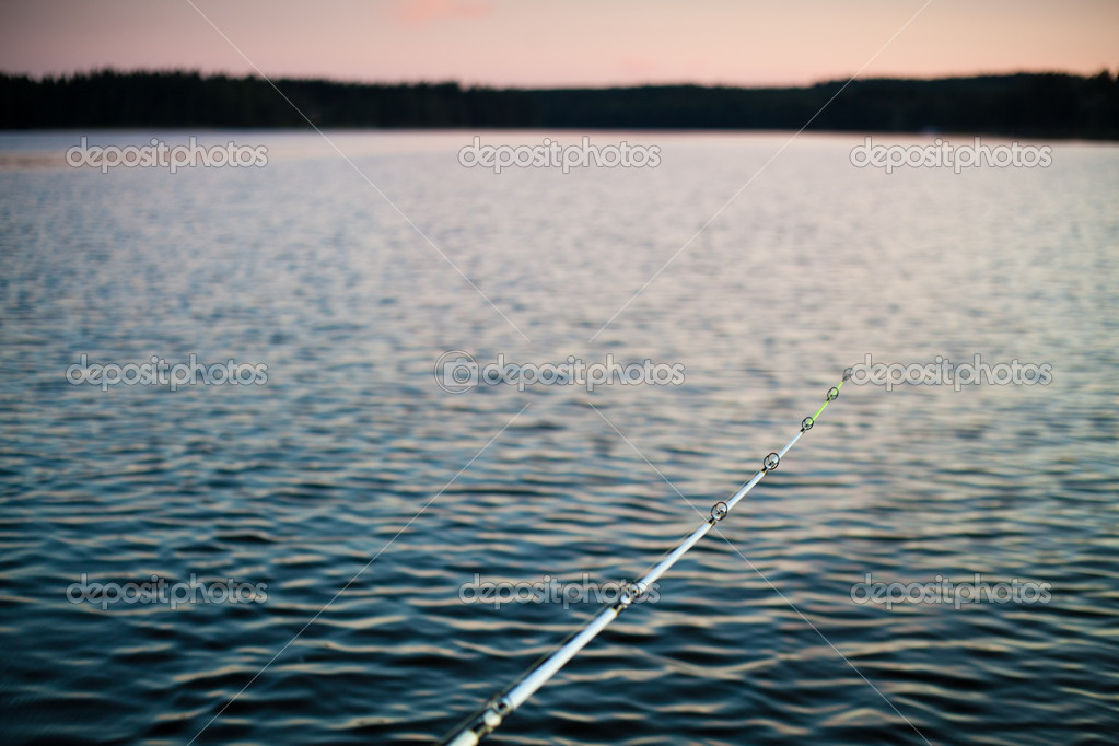 Fishing rod with lake's twilight background  Stock Photo #6698969