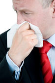 Ill businessman with tissue — Stock Photo