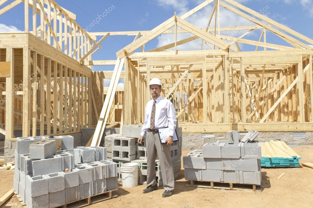 Banker inspecting construction site for new homes his company is financing  Stock Photo #6737591