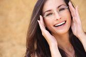 Young laughing woman wearing eyeglasses