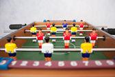 Vicino di opposte squadre di gioco del calcio tavolo