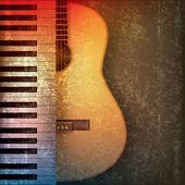 Abstract grunge background with piano and guitar