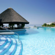 thumbnail of Tiki hut and bar by swimming pool of luxury hotel