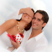 Happy young couple with wedding, birthday, engagement or wedding gifts