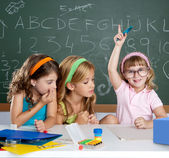 Boring student with clever children girl raising hand