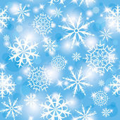 Blue shiny seamless pattern with white snowflakes