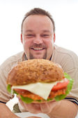 Muž spokojený s velikosti jeho hamburger