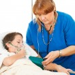 Постер, плакат: Nurse Caring for Sick Child