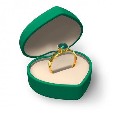 Green heart-shape box with golden ring with jewels