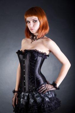 Attractive woman in black corset