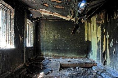 Old abandoned burned house inside hdr