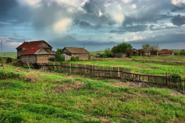 Old ranch on green field HDR