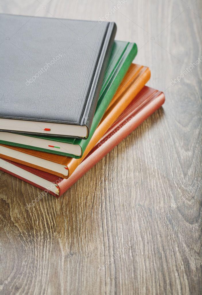 Notebooks on wooden board