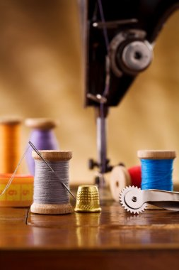 Small sewing wooden bobbin with other items