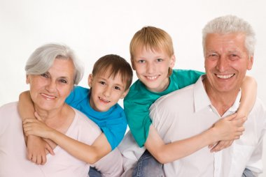 Happy smiling grandparents with their grandsons