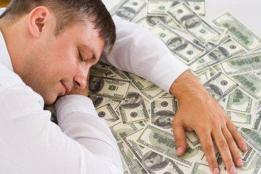 Sleeping man and money on white