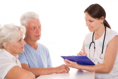 Young doctor testing old couple.JPG