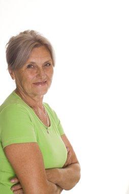 Beautiful older woman in green