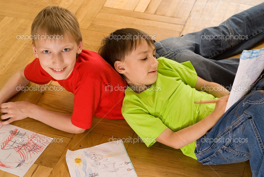 Two Brothers Lying And Draw Stock Photo C Privilege 5510582