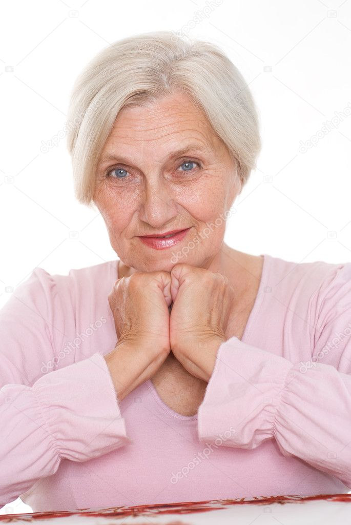 Smiling old women at the desk
