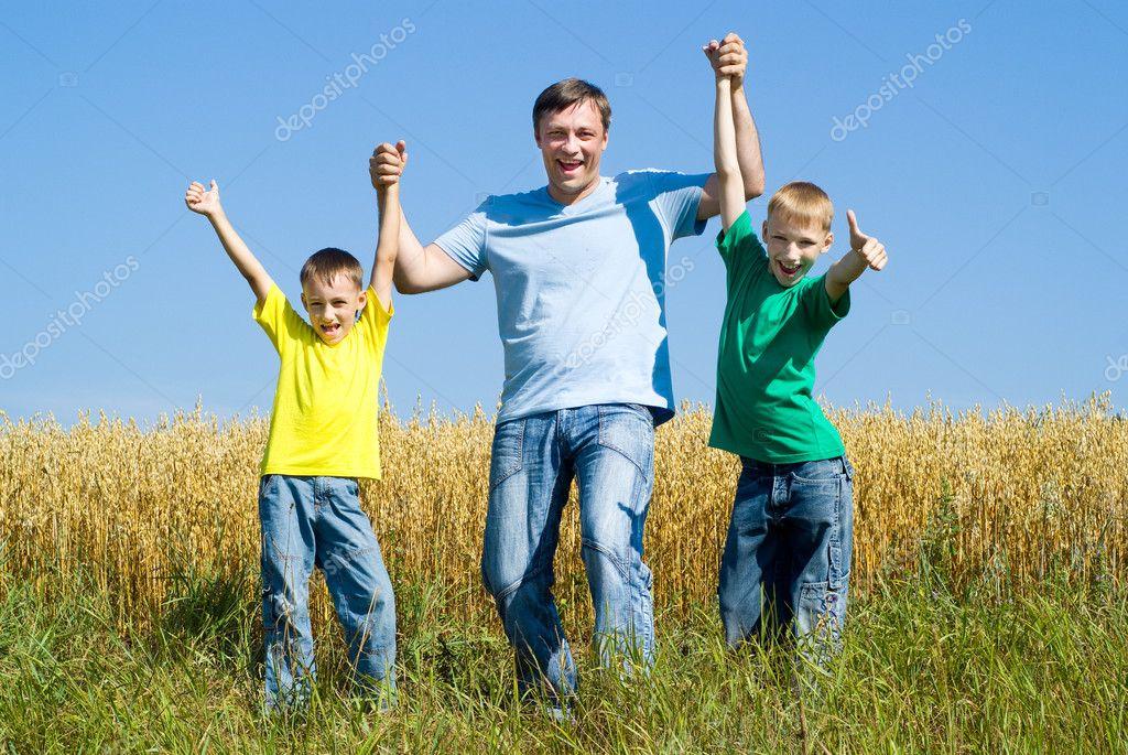 Happy fathyer resting with boys