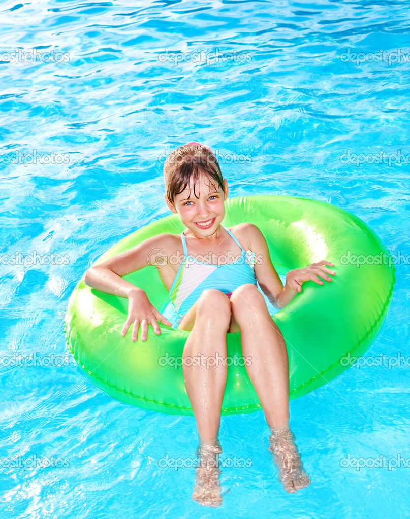 Child sitting on inflatable ring .
