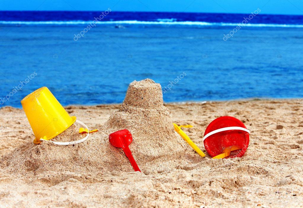 Kids toys on sand beach.