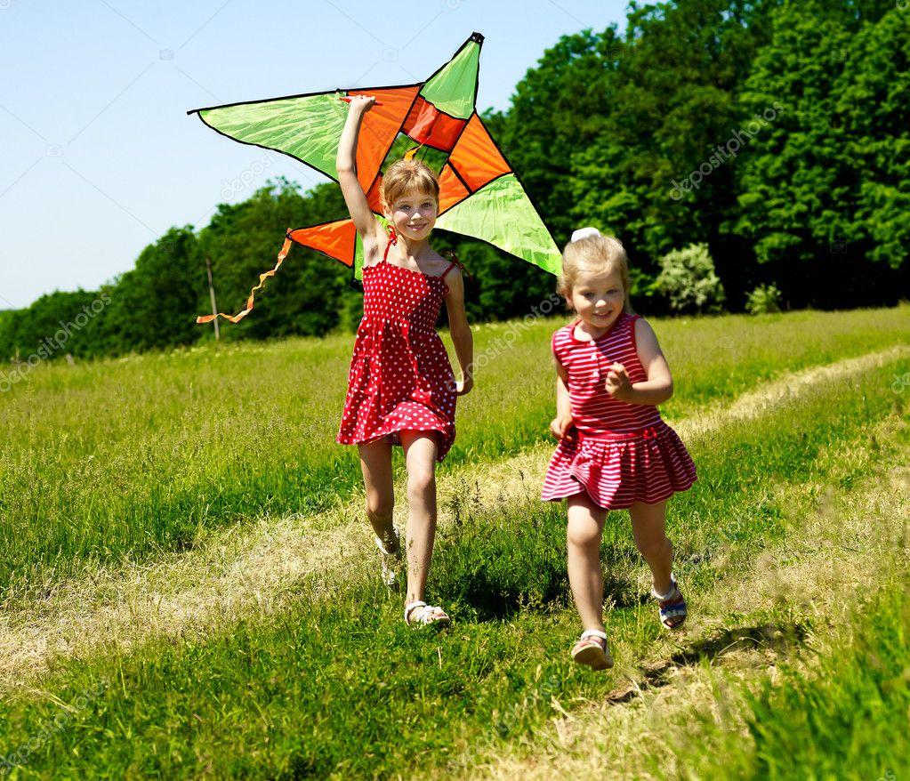Kids flying kite outdoor.