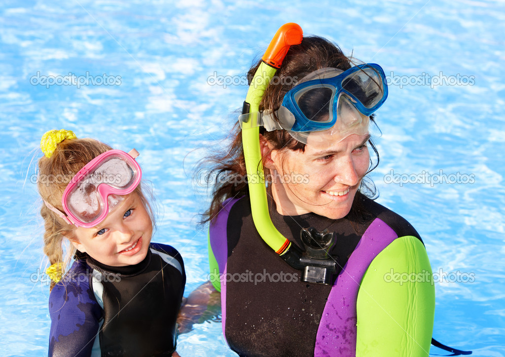 Child with mother in swimming pool .