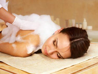 Massage of woman in beauty spa.