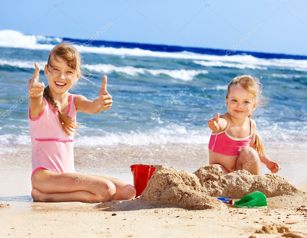Kids playing on beach.