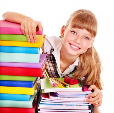 School child holding stack of books.