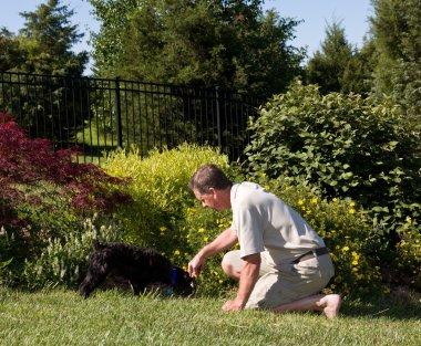 Senior man digging in garden