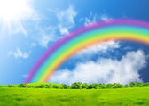 Rainbow in the blue sky