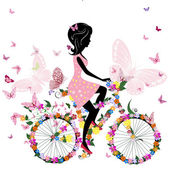 Fotografie Girl on a bicycle with a romantic butterflies