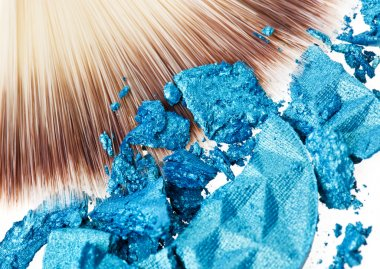 Makeup wide brush with blue crushed eye shadow