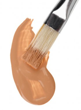 Beige liquid foundation makeup stroke with brush, isolated on wh