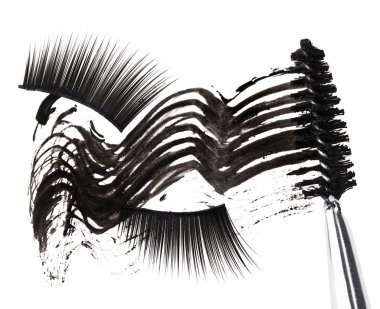 Black mascara stroke, brush and false eyelashes abstract composi