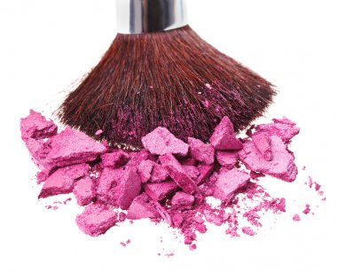 Makeup brush with purple crushed eye shadow, isolated on white m