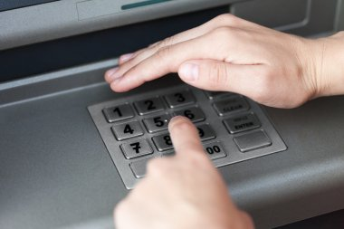 Entering atm cash machine pin code