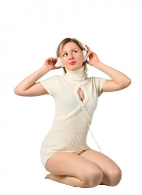 A beautiful girl sitting and listening to music on headphones