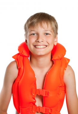 Teen in an orange life jacket for water sports - on a white back