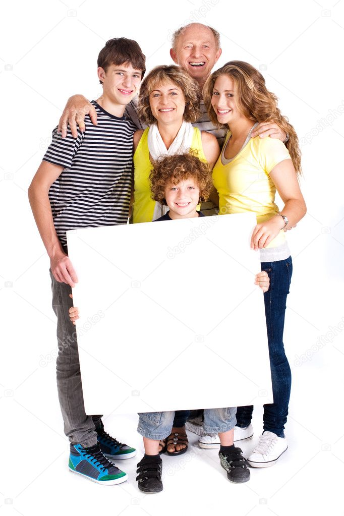 Portrait of a happy family holding a billboard