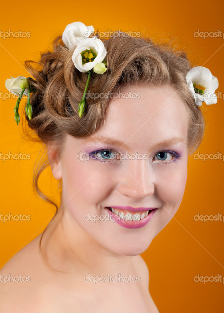 Portrait of beautiful girl blonde with flowers in her hair .isolated on white background.