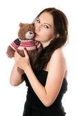 Young woman kissing teddy-bear