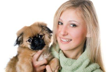 Сheerful woman with a pekinese