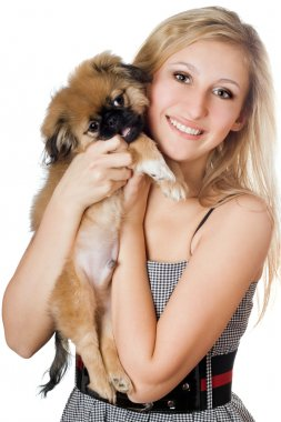 Smiling woman with a puppy